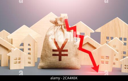 City residential buildings and Yen Yuan money bag with a red down arrow. Low cost of real estate. Low demand for home buying. Lower mortgage interest
