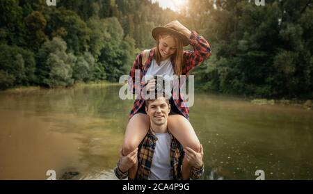 good looking couple having fun in the fresh air, close up photo. positive feeling and emotion