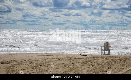 Wind advisory brings rough surf to Lake Michigan's Illinois shore on a summer day.