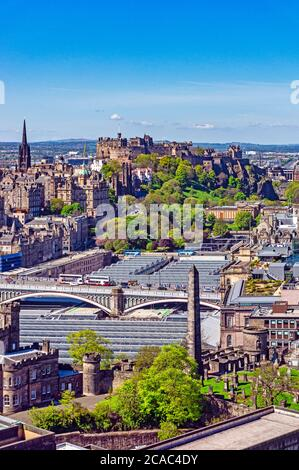 View from Nelson Monument on Calton Hill across Waverley Railway Station glass roof towards Edinburgh Castle in Edinburgh Scotland UK - Stock Photo
