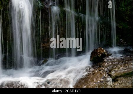 longexposure of a waterfall at Griessbach Falls in Berner Oberland - Stock Photo