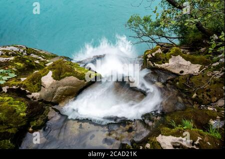 longexposure image of estuary of a waterfall at Griessbach Falls in Berner Oberland - Stock Photo