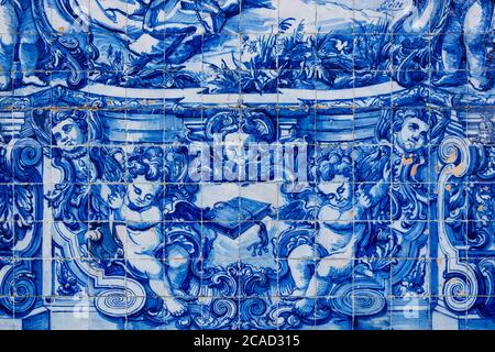 Porto, Portugal - 02/17/2020: Tile painting, religious art. Blue traditional portuguese tiles, with painted angels. Santa Catarina church - Stock Photo