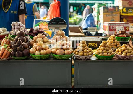 Vegetable market. Many different vegetables in multi-colored baskets next to each other are sold - Stock Photo