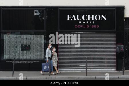*** STRICTLY NO SALES TO FRENCH MEDIA OR PUBLISHERS - RIGHTS RESERVED ***August 03, 2020 - Paris, France: The front of the Fauchon store on Place de la Madeleine, a famous French caterer that shut down in June following the coronavirus lockdown. The caterer said it went out of business because of the cumulative effects of the Yellow Vest movement in 2018, the strike against pension reform in 2019, and the Covid-19 pandemic in 2020. Facade de la boutique Fauchon place de la Madeleine, qui a ferme suite a la crise du covid-19. - Stock Photo