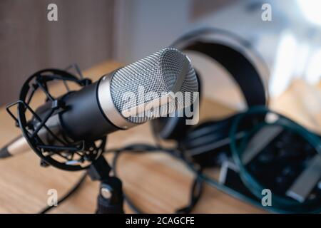 Microphone -  professional condenser microphone in a home studio for podcast, music production, voice over, recording - Stock Photo