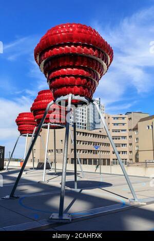 'Dortmunder Rosen' vibrant red public art installation made from recycled car lights by Winter / Hoerbelt, outside Dortmunder U museum, Germany - Stock Photo