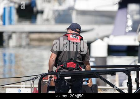 Eastbourne, East Sussex, UK. 7th Aug, 2020. Beach goers bask in 30C sunshine at this holiday resort as the RNLI stand ready to help those who may find themselves in difficulty as they are drawn to the waters around our coast . Credit: Alan Fraser/Alamy Live News - Stock Photo
