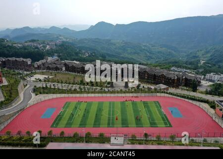 Weining. 7th Aug, 2020. Photo taken with a drone on Aug. 7, 2020 shows players of 'Green Pepper' football team attending a training session at Shimen Minzu Middle School in the Yi, Hui and Miao Autonomous County of Weining, southwest China's Guizhou Province. Over 40 local students formed a football team called 'Green Pepper' and devoted themselves to football training during summer vacation in Shimen Township of Weining County, a rural place with an average altitude of over 2,000 meters. Credit: Jin Liangkuai/Xinhua/Alamy Live News - Stock Photo