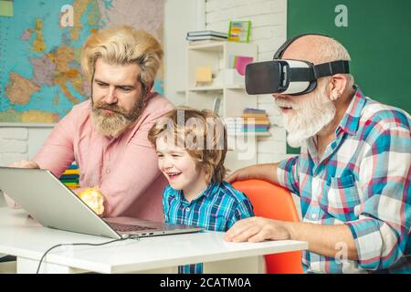 Three generations of men having fun together. GrandFather, father and son playing computer games at home. Parenting childhood values weekend.