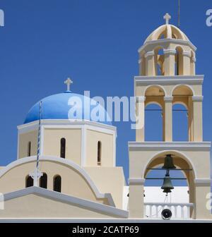 St George church (Ekklisia Agios Georgios) closeup of blue dome and bell tower in Oia, Santorini, Greece - Stock Photo