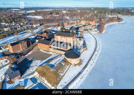 Above the ancient fortress of the city of Hameenlinna on a March day (aerial photography). Finland - Stock Photo