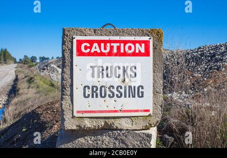 New Zealand Countryside Scenes: Danger and Warning signs e.g. on Irrigation Infrastructure; Forestry Plantations; River Gravel Extraction. - Stock Photo