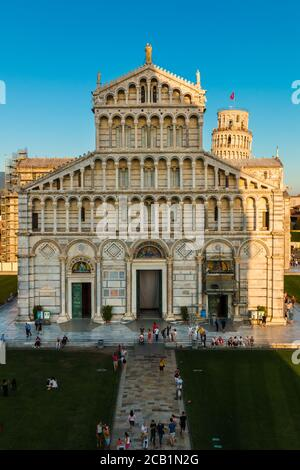 Nice portrait shot of the medieval Pisa Duomo façade with the famous Leaning Tower in the background, taken from a window of the Pisa Baptistery of... - Stock Photo