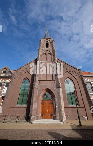 Front with entrance of the Reformed church of Lemmer and the associated cultural center Het Baken, the rectory and the sexton's house - Stock Photo