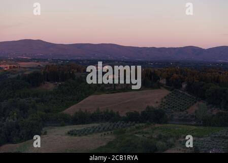 Evening lights on the Tuscan landscape, view from the town of San Gimignano