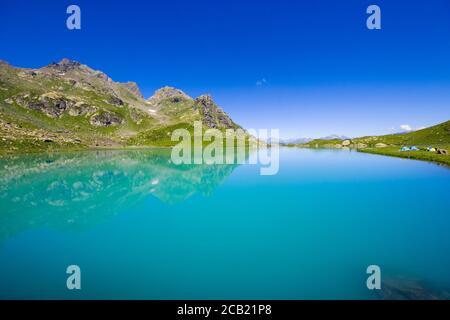 Alpine mountain lake landscape and view, blue beautiful and amazing lake panorama, wide angle lens landscape and mountain reflections in Okhrotskhali