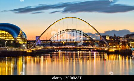 Looking up the River Tyne towards the iconic Tyne, Millennium and High Level Bridges. Captured at sunset with reflections in the water.
