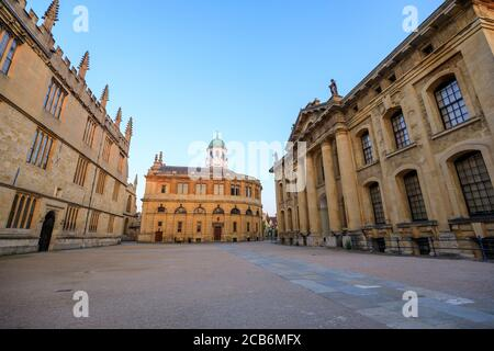 The side of the Sheldonian Theatre and the Clarendon Building with no people around, early in the morning. Oxford, England, UK. - Stock Photo