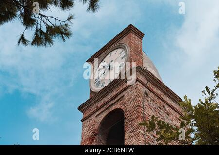A medieval bell and clock tower of an ancient church (Pesaro, Italy, Europe)