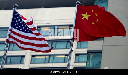 Beijing, China. 11th Aug, 2020. Both the American and Chinese national flags fly together outside an American hotel in downtown Beijing on Tuesday, August 11, 2020. Tensions between the U.S. and China continue to increase due to issues involving Hong Kong, Xinjiang, Huawei, Taiwan, Espionage and China's military expansion in the South China Sea. Photo by Stephen Shaver/UPI Credit: UPI/Alamy Live News