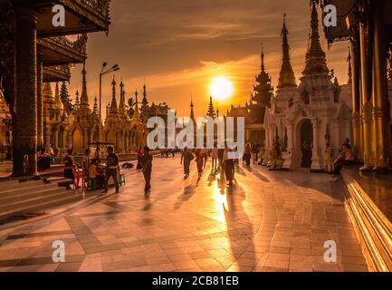 Yangon, Myanmar - December 18th 2017: Sunset light on the Shwedagon Pagoda in Yangon, Myanmar