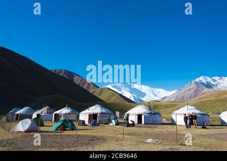 Morning Landscape of Lenin Peak (7134m) at Tourist Yurt camp of Tulpar Kol Lake in Alay Valley, Osh, Kyrgyzstan. Pamir mountains in Kyrgyzstan. - Stock Photo