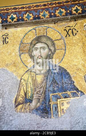 The Deësis mosaic, ancient Christian art showing Christ, on the upper gallery inside Hagia Sophia. Istanbul. Turkey. - Stock Photo