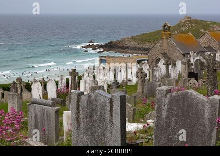 View over Barnoon Cemetery towards surfers at St. Ives, Cornwall UK - Stock Photo