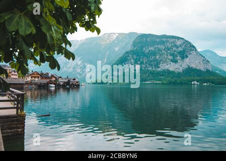 hallstatt city quay with beautiful view of lake and alpine range - Stock Photo