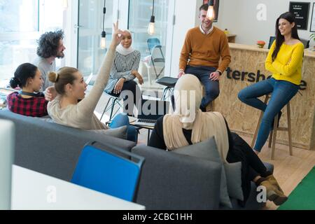 Startup Marketing Idea Presentation. Group of Young multiethnic Coworkers Making Great Business Decisions. Creative Team Discussion Corporate Work Con