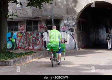 PIN AG postman on his bicycle