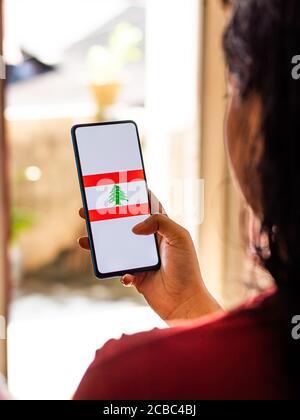 Assam, india - Augest 8, 2020 : Flag of Lebanon on phone screen.