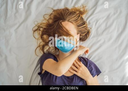 Extremly tired young woman lying on the bed, home alone. self-isolation at home, quarantine due to pandemic COVID 19. Mental health problems in self