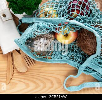 Net bag with reusable  glass jars, fruits and bamboo cutlery. Zero waste concept. Eco friendly. Flat lay