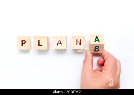 Person switching a wooden bucket between Plan A and B. Business concept