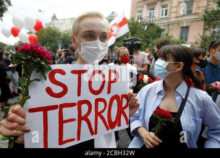 An activist holds a placard during a solidarity march outside the Embassy of Belarus.Belarusian citizens living in Ukraine, members of Amnesty International and Ukrainian activists held a rally in support of Belarusians who protested against vote rigging in the presidential election, demanding the right to respect the freedom of speech and freedom of peaceful assembly.