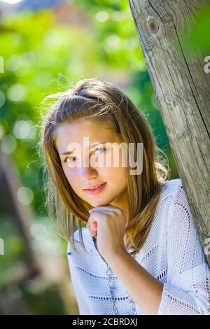 Teengirl portrait is serious curious but cautious with caution expecting waiting - Stock Photo