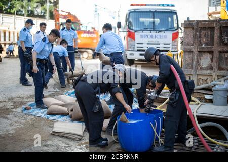 Hong Kong. 15th Aug, 2020. Police officers work at a construction site where a bomb was found in Hong Kong, south China, Feb. 29, 2020. TO GO WITH 'Spotlight: Meet the heroes defusing WWII bombs in Hong Kong' Credit: Xinhua/Alamy Live News Stock Photo