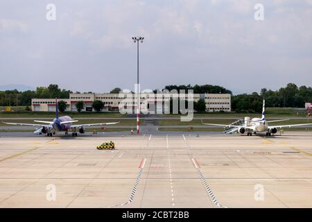 Budapest, Hungary - 08 15 2020: Airplanes at the Ferenc Liszt International Airport in Budapest, Hungary on a summer day.