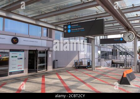 Budapest, Hungary - 08 15 2020: Entrance of the Ferenc Liszt International Airport in Budapest, Hungary on a summer day.