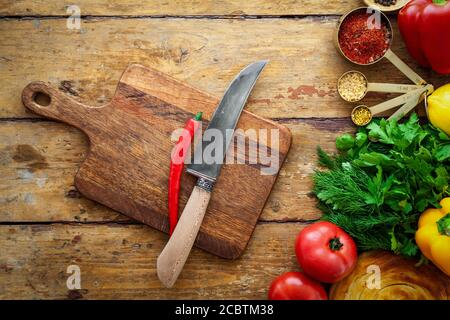 Fresh vegetables and healthy ingredients, knife on cutting board