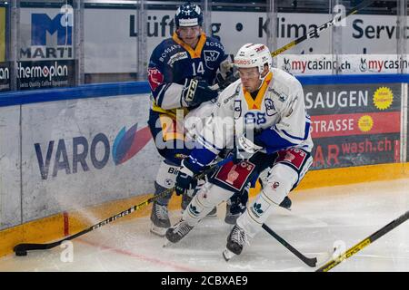 Anton Gradin # 88 (EVZ Academy) in front of Livio Stadler # 14 (EV Zug) on the puck during the National and Swiss League preparation ice hockey game between EV Zug and the EVZ Academy on August 16, 2020 in the Bossard Arena in Zug. Credit: SPP Sport Press Photo. /Alamy Live News