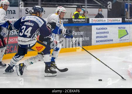 Anton Gradin # 88 (EVZ Academy) escaped Claudio Cadonau # 34 (EV Zug) during the National and Swiss League preparation ice hockey game between EV Zug and EVZ Academy on August 16, 2020 in the Bossard Arena in Zug. Credit: SPP Sport Press Photo. /Alamy Live News