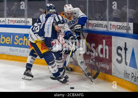 Anton Gradin # 88 (EVZ Academy) against Dario Simion # 59 (EV Zug) and Claudio Cadonau # 34 (EV Zug) during the National and Swiss League preparation ice hockey game between EV Zug and EVZ Academy on August 16, 2020 in Bossard Arena in Zug. Credit: SPP Sport Press Photo. /Alamy Live News