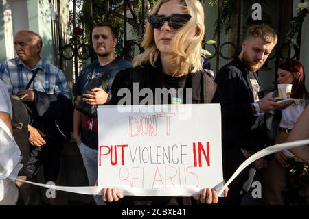 Moscow, Russia. 16th of August, 2020 A woman holds a banner during a protest rally against the official results of the Belarusian presidential election in front of Belarusian Embassy in Moscow, Russia - Stock Photo