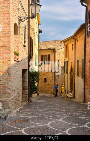 One of the picturesque cobbled alleys in Fiorenzuola di Focara (Marche), a beautiful village located in the Monte San Bartolo Natural park. - Stock Photo