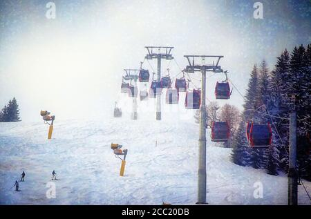 Austria  snowfall landscape, cable cars over a ski slope with skiers in winter holiday on the Tauern mountains