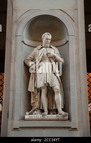 Michelangelo Buonarroti statue on the facade of the Uffizi gallery on Piazzale degli Uffizi - Stock Photo