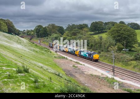 Direct Rail Services class 37 and class 20 locomotives running light engine along the west coast mainline - Stock Photo